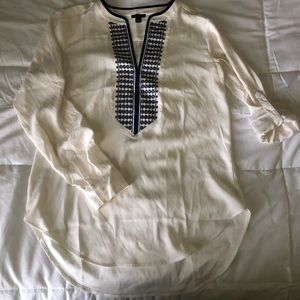 Ann Taylor cream top with navy blue stitching
